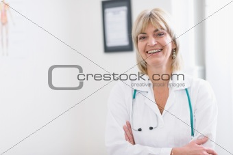 Portrait of smiling middle age doctor