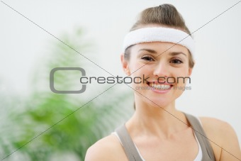 Portrait of smiling woman in sportswear
