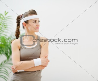 Fitness woman in sportswear looking on copy space