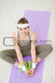 Portrait of happy healthy woman at gym