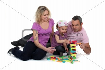 Couple and girl playing with blocks