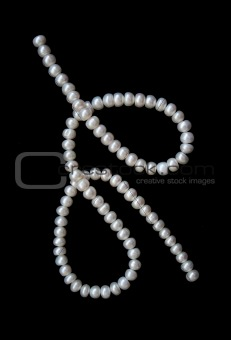 White pearls on the black velvet 