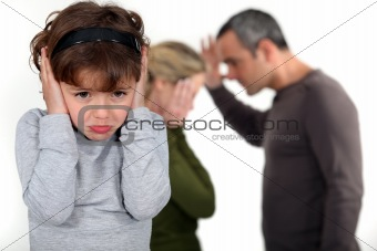 couple having a quarrel in front of their little girl