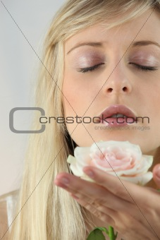 Blond woman holding flower