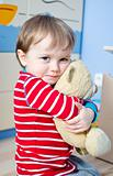Sweet child with teddy bear