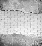 Grunge background from a damaged brick wall