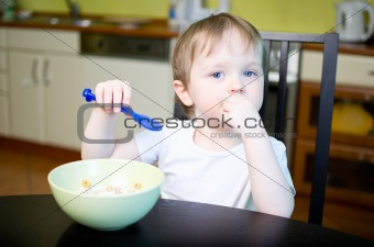 Little boy eating cereals