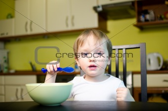Little child eating breakfast