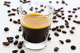 hot espresso coffee with coffee beans