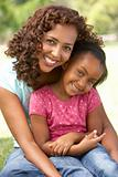 Portrait Of Mother And Daughter In Park