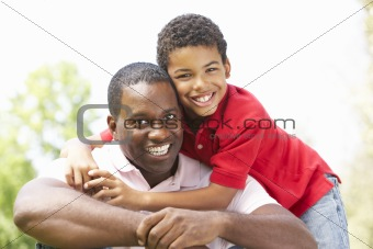 Portrait Of Father And Son In Park