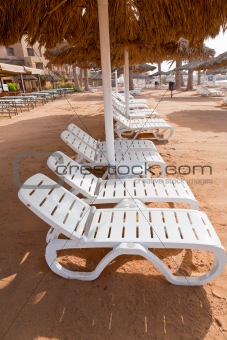 plastic beach beds on coral bay
