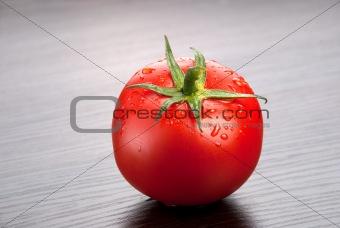Tomato on dark background