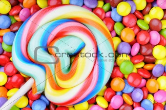 Striped lollipop and multicolored smarties
