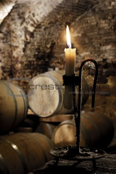 Old candle in a wine  barrel cellar