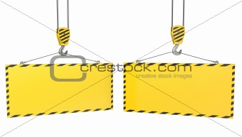 Two crane hooks with blank yellow plates