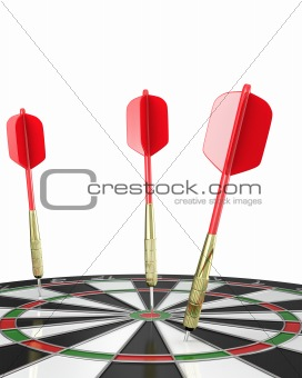 Three darts stuck in a board, top view