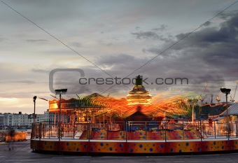 Fun fair carnival ride landscape with moving bright lights