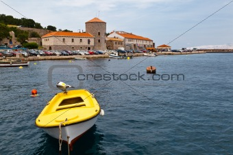 Yellow Boat in Mediterranean Town Senj in Croatia