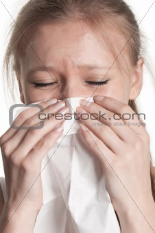 Pale Woman Sneezing
