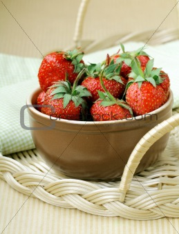 Ceramic bowl with ripe fresh strawberries