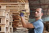 Man arraging pallets, horizontal shot