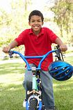 Boy Riding Bike In Park