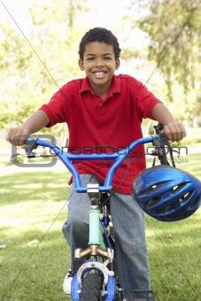 Boy Riding Bike In Park