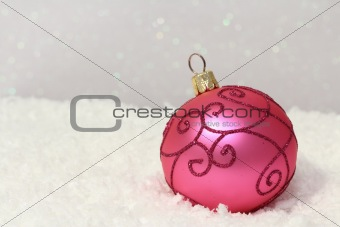 Christmas bauble on snow