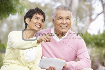 Portrait Of Senior Couple Looking At Map