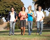 Group Of Teenagers Running In Park