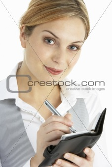 Blonde Businesswoman Writing In Diary