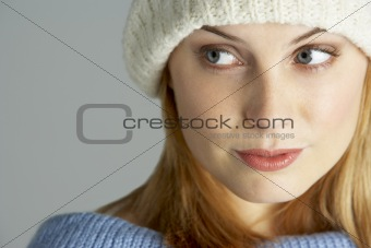 Portrait Of Young Woman Wearing Winter Clothes