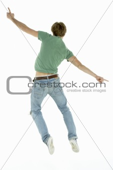 Back View Of Man Jumping In Air
