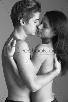 Portrait Of Semi-Naked Couple Kissing