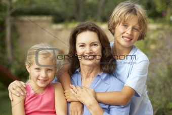 Grandmother With Grandchildren In Garden