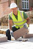 Construction Worker Laying Blockwork