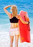 Girl surfer on the beach