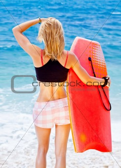 Girl surfer on the beach