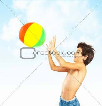 Happy boy with beach ball