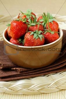 Ceramic bowl with ripe fresh strawberries
