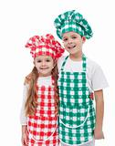 Happy chefs - boy and girl with aprons and hats
