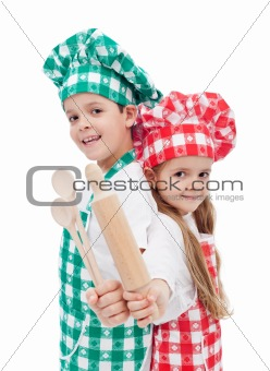 Happy chef kids with wooden cooking utensils