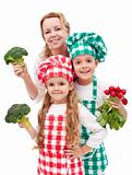 Happy family preparing healthy vegetables meal