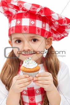 Little chef holding muffin