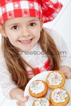 Happy little chef proud of her muffins
