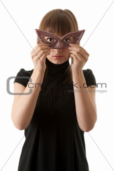 Beautiful girl in black dress and wearing a mask