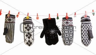 Winter knitted gloves hang