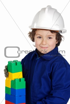Future builder constructing a brick wall with toy pieces
