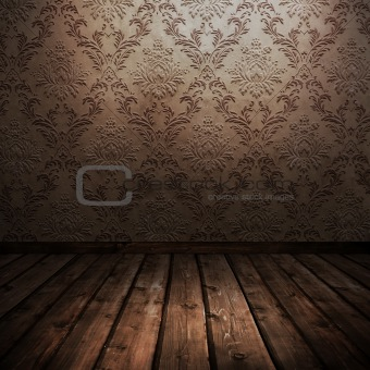room with wooden floors and old wallpaper
